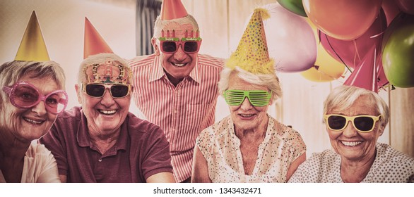 Group of seniors celebrating a birthday in the retirement house