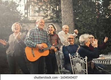 group of seniors celebrating in the garden