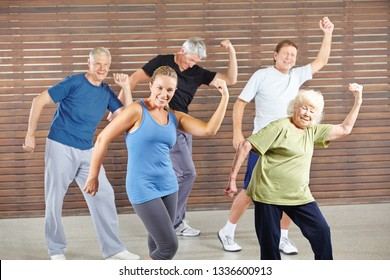 Group of seniors dancing together Bokwa in the fitness center