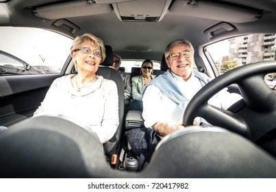Group of seniors driving in the car