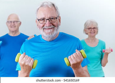 Group Of Seniors In Fitness Class Using Weights