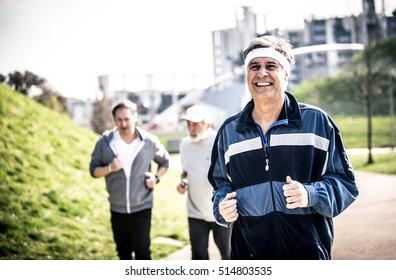 Group of seniors making jogging at the park
