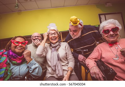 Group of seniors taking selfie in the nursing house. Making big crazy party