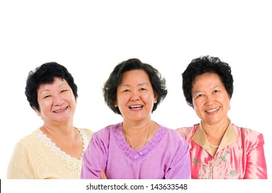 Group of seniors. Three Asian senior women smiling happily isolated on white background.