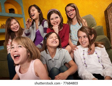 Group of seven happy little girls laugh out loud