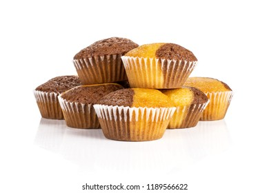Group of seven whole fresh baked marble muffin isolated on white background