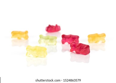 Group of seven whole gummy bear isolated on white background