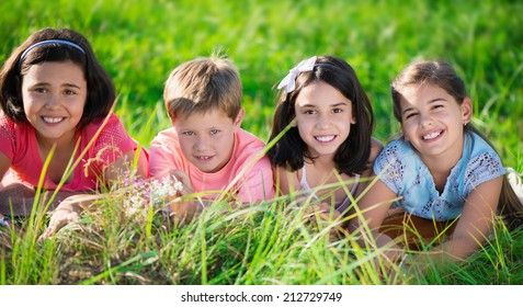 Group of several children resting in international camp