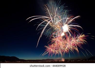 Group of Several Fireworks Bursts for July 4th Celebration