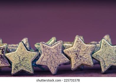 group of shiny stars on purple background
