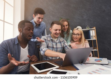 Group of shocked professional agents looking and gesturing at screen of computer, lost the tender, program error, copy space