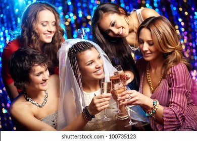 Group shot of young women celebrating their friend'??s forthcoming marriage, hen party