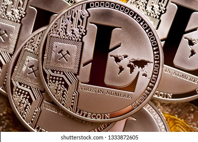 Group of silver litecoin coins, close-up. Cryptocurrency concept, e-banking.