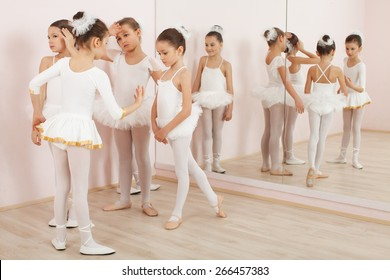 Group of six little ballerinas posing together and practicing for performance. They are good friend and amazing dance performers