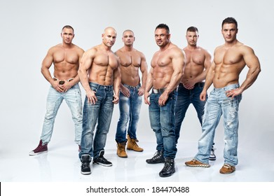Group of six muscular young sexy wet naked handsome man posing