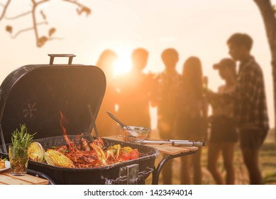 Group of six teenagers having fun on barbecue party