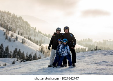 Group of skiers, children and adults, skiing on a sunny winter day in austrian Apls