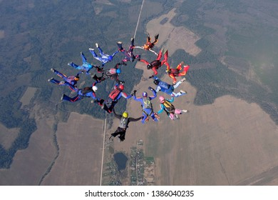 A group of skydivers is in the sky.