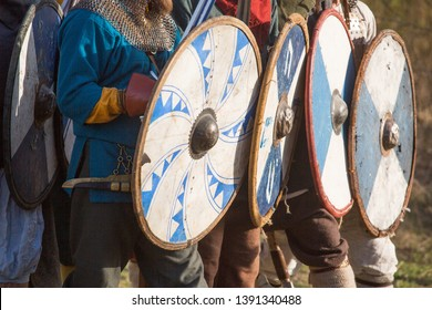 Group of slav warriors in reenactment battle rehearsal training, view on shieds