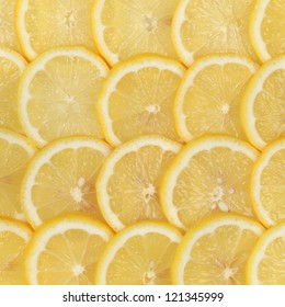 Group of sliced lemons forming a background