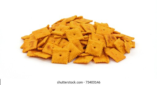 A group of small square tasty cheese crackers.