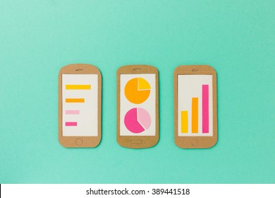 Group of smart phones with different charts - useful image for analytic apps, financial report, app development - with space for your copy text
