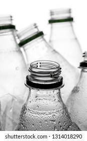 group of smashed empty plastic bottles, isolated on white background