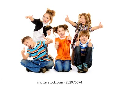 Group of smiling children sitting together. Isolated over white.