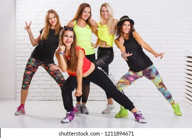 Group of smiling fitness girls having fun together. Aerobic dance fitness group concept background