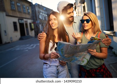 Group of smiling friends traveling. Friendship, travel, vacation, summer and people concept.