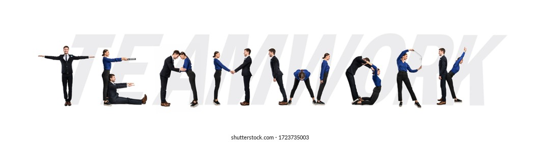 Group of smiling office people forming Teamwork word isolated over white background, studio wall, panorama