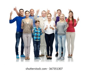 group of smiling people showing thumbs up