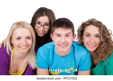Group of smiling students looking at camera together over a white background