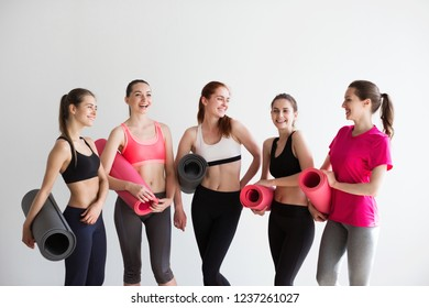 Group smiling women after training in fitness studio. Fitness, sport concept.