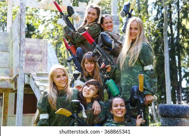 Group of smiling young girls with paintball ammunition