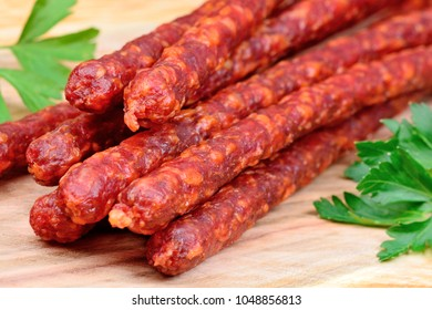 Group of smoked sausages on wooden table