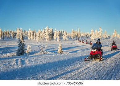 Group of snowmobiles in Lapland, near Saariselka, Finland