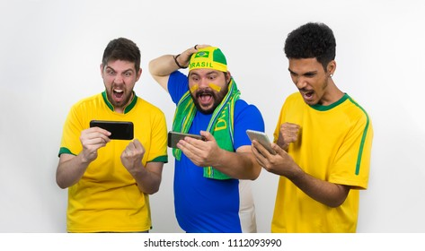 Group of soccer fans  looking cell phone isolated on white background