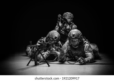 Group of soldiers in military uniform are shooting. Heavy machine gun, grenade launcher. SWAT concept. Mixed media