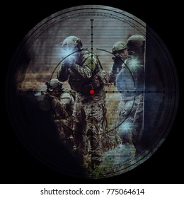 group of soldiers in the sight of a sniper rifle