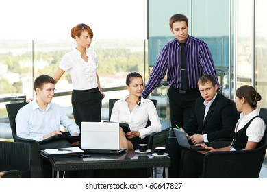 Group of some business people working in the open air office (WARNING! Low depth of field)