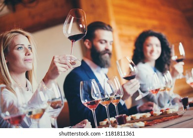 A group of sommeliers tasting wine at the winery