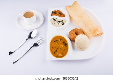 group of south indian food dosa, idli or idly, vada, sambar coconut chutney and hot tea, south indian variety platter