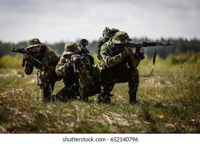 A group of special forces in a field with weapons