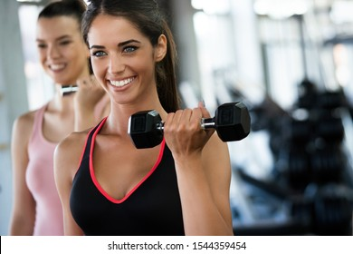 Group of sportive people in a gym. Concepts about lifestyle and sport in a fitness club