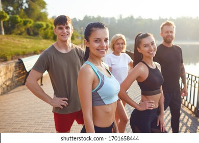 A group of sporty people training in the park.
