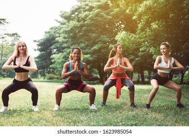 Group of sporty young woman doing workout at public park in the morning,Best friends warming up body at outdoor
