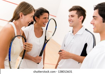 Group of squash players talking at the court