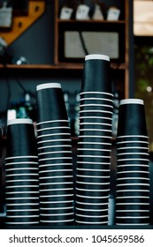 Group of Stack coffee black paper cup, space to put logo, life cafe background