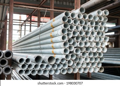 Group of Stack of iron pipes in an iron shop